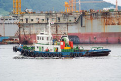 View of a tug in a commercial harbour Stock Photos