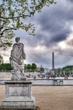 View from Tuileries Gardens. The view of Concord Square and  Triumphal Arch from Tuileries  Gardens, Paris, France Royalty Free Stock Image
