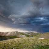 View of Tulpar Kul lake in Kyrgyzstan during the storm Stock Images