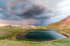 View of Tulpar Kul lake in Kyrgyzstan during the storm Royalty Free Stock Photography