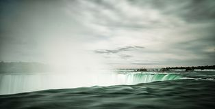 View of the tumbling waters of Horseshoe Falls at Niagara Falls with water steam rising from the cascading waters. A view of the tumbling waters of Horseshoe royalty free stock photography