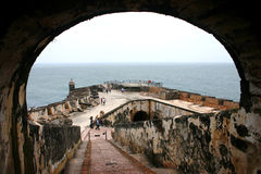 View from the Tunel to Third Level at El Morro. View from the tunnel that goes to el Morro Third Level.  At the backgroud is the oldest structure, the tower Royalty Free Stock Images