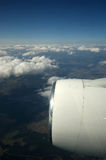View of the turbine airplane, clouds and the Earth Royalty Free Stock Photos
