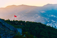 View of Turkish flag on castle of Alanya Stock Photo