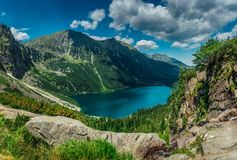 View on the turquoise color lake between high and rocky mountains. Beautiful alpine landscape stock photo