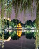 View of Turtle tower through weeping willow tree in Hoan Kiem la. Ke, Hanoi, Vietnam Royalty Free Stock Photos