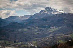 View of Tuscany in the area of Barga. A view of a snow covered mountain peak in Tuscany. the peak is overlooking the city of Barga Royalty Free Stock Photo