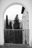 A view of Tuscany landscape from an arch. Florence. Italy. Photo in black and white color style. royalty free stock photo
