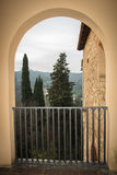 A view of Tuscany landscape from an arch. Florence. Italy. Vignette effect. royalty free stock photos