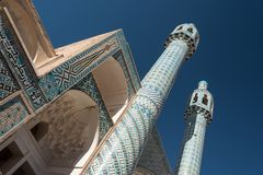 View of twin minarets and portico with decorative tiled mosaics, Iran. View of twin minarets and portico with decorative tiled mosaics, part of Shah Nematollah stock photos