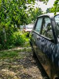 View of two antique cars in a garden stock photos