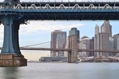 Two bridges in New York City. View of two bridges on the East River Royalty Free Stock Image