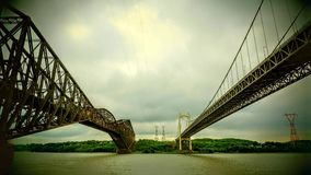 View between two bridges over the St. Lawrence River. With a nostalgic effect on a cloudy day before a storm in Quebec Canada stock photo