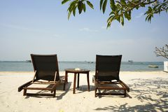 View of two chairs on the beach, thailand royalty free stock image