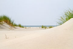 View between two dunes on the sea Royalty Free Stock Image