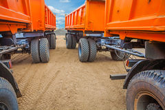 View through two rows of tippers Stock Photo