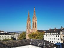 View on two steeple of the church in Wiesbaden Germany. Photographed during a sightseeing tour from a rooftop in wiesbaden germany stock image