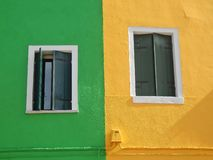 View of two windows. In yellow and green wall Stock Photography
