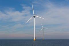 View of two windturbines in the Dutch Noordoostpolder, Flevoland Stock Photo