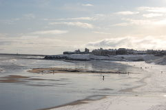 View of Tynemouth Priory. From Cullercoats across snowy beach Royalty Free Stock Images