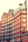View of typical English building in old red bricks, London. The characteristic Albert Hall Mansions in London. The Mansions are London`s first ever block of Stock Images