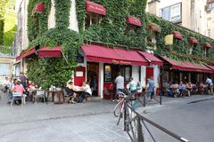 View of typical French cafe Chez Marianne in the quarter Marais, the historic Parisian district set on the Right Bank . Paris, France-June 26, 2018 : View of stock image