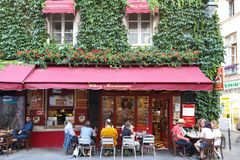 View of typical French cafe Chez Marianne in the quarter Marais, the historic Parisian district set on the Right Bank . Paris, France-June 26, 2018 : View of royalty free stock images