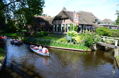 View of typical houses of Giethoorn,The Netherlands.  The beautiful houses and gardening city is know as Royalty Free Stock Photography