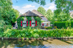 View of typical houses of Giethoorn,The Netherlands. Royalty Free Stock Image