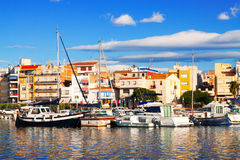 View of typical mediterranean town from sea. L'Ampolla Stock Photo