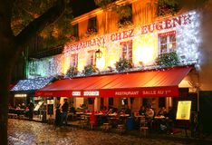 The View of typical paris cafe Chez Eugene in Paris, Montmartre area , France. stock photo