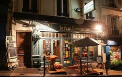 The View of typical paris cafe Le Petit Parisien in Paris, Montmartre area , France. Stock Photo