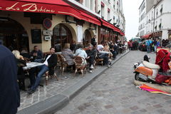 View of typical paris cafe on May 1, 2013 in Pari Stock Photography
