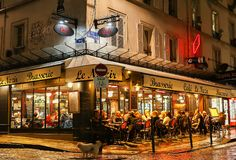 The View of typical paris cafe Nazir in Paris, Montmartre area , France. Royalty Free Stock Images