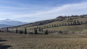 View of the typical Sienese countryside with Mount Amiata covered in snow in the background, Tuscany, Italy. Europe stock photo