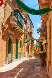 A view of the typical small street Saint Dominic,  Birgu, Malt. A view of the typical small street Saint Dominic, decorated to the holiday, Birgu, Malta Stock Image