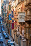 A view of the typical Street of Valletta with traditional maltes. Valletta, MALTA - JULY 24, 2015 A view of the typical Street of Valletta  (St. Paul's street) Royalty Free Stock Image