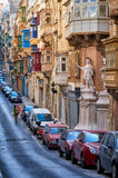 A view of the typical Street of Valletta with traditional maltes. Valletta, MALTA - JULY 24, 2015 A view of the typical Street of Valletta  St. Paul`s street Stock Photography