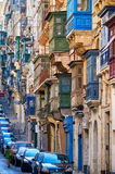 A view of the typical Street of Valletta with traditional maltes. Valletta, MALTA - JULY 24, 2015 A view of the typical Street of Valletta  St. Paul`s street Royalty Free Stock Image