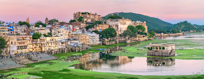 View of Udaipur, India, on sunset. Maharajah palace and lake Pichola in the old town of Udaipur, India, on sunset stock photo