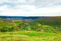View of ukrainian village with a valley and mountains, shot from drone stock photo