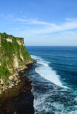 View of Uluwatu Cliff at sunny day in Bali, Indonesia Royalty Free Stock Photos