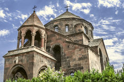 View of the umbrella-shaped roof with a cross and rotunda with columns on the church. Great martyr St. Hripsime Stock Photos