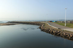 View of Umgeni River Mouth Lined by Walkway Stock Photo