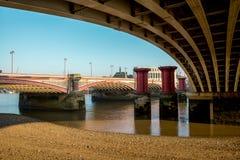 A view from under Blackfriars Bridge to old bridge pillars, London. England Royalty Free Stock Image