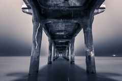 View from under Manhattan Beach Pier. Monochrome view from under Manhattan Beach Pier by night in Los Angeles, California royalty free stock photo