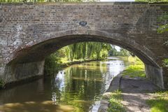 View under arch bridge in Cheshire UK. View under old arch bridge at the Trent and Mersey Canal in Cheshire England United Kingdom Royalty Free Stock Image