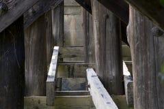 Wooden bridge supports stock photos