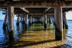 Under Sopot Pier on Baltic Sea in Poland. View under the Sopot pier on Baltic Sea in Poland, the longest wooden pier in Europe, vanishing point perspective royalty free stock photo