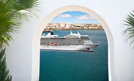 Cruise ship sailing from port. View from under the white stone arch of luxury cruise ship sailing from port Stock Photos